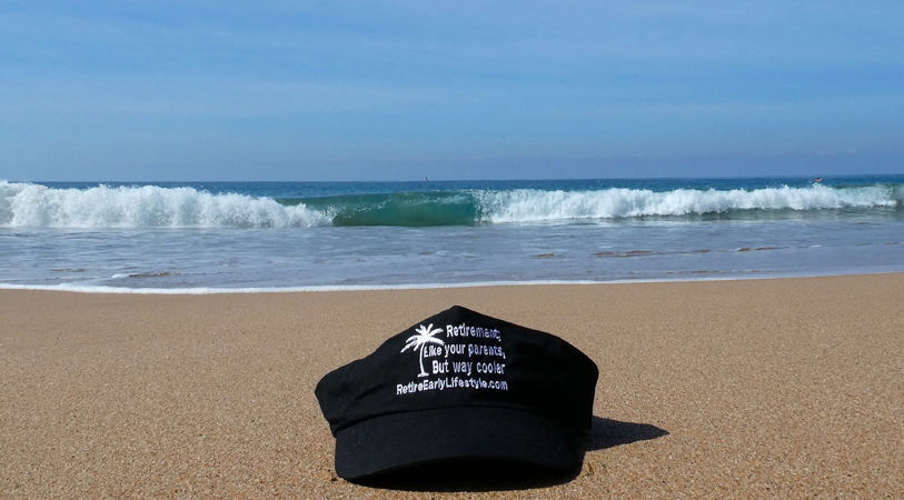 Our Retire Early Lifestyle cap on the beach