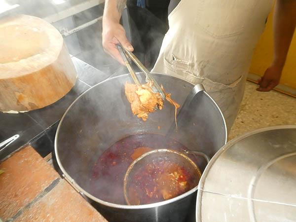 Cooking birria in a deep pot, La Birria del 99, Queretaro, Queretaro, Mexico