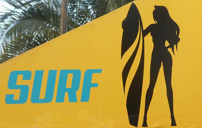 Attractive surfer poster in Sayulita, Mexico