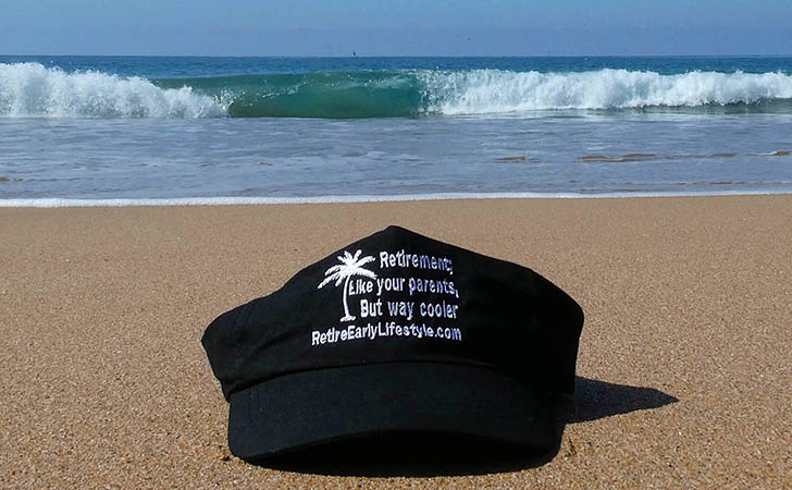 Retire Early Lifestyle hat on the beach
