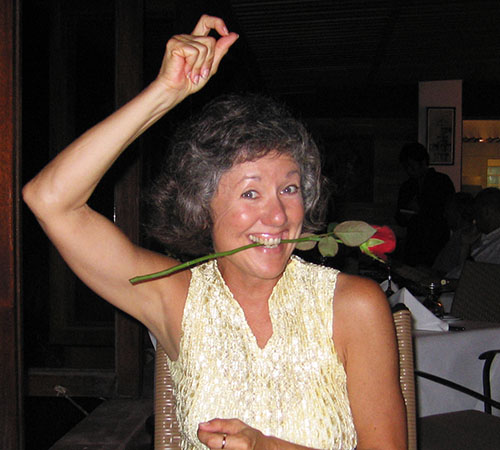 Akaisha goofing off with a rose between her teeth. Have fun with Life!