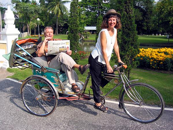 Billy reads the Bangkok Post as Akaisha peddles - Joking around in a Jak-a-Ran, Chiang Mai, Thailand