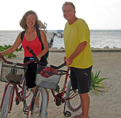 Billy and Akaisha bicycling on the Beach in Belize