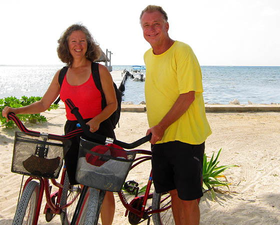 Billy and Akaisha bicycling on the beaches of Belize