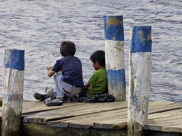San Antonio boys fishing off the dock