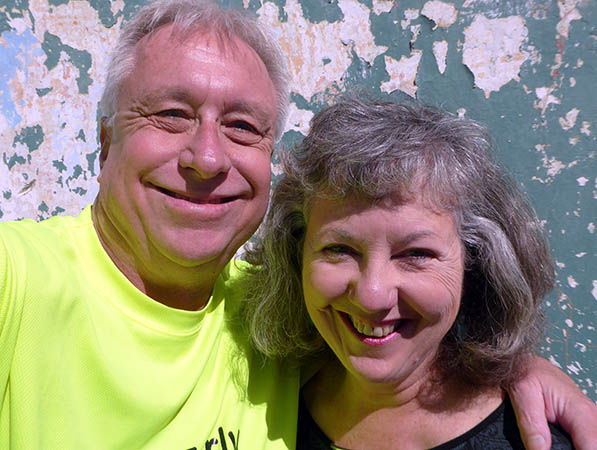 Billy and Akaisha in front of ancient wall in Antigua, Guatemala
