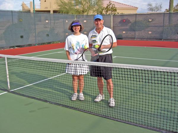 Billy and Akaisha playing tennis in Arizona