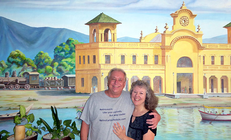 In front of a mural of The Old Train Station, Chapala, Mexico