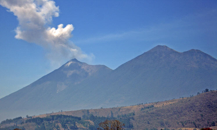 Volcan Acatenango on the right and smoking Volcan de Fuego on the left, as seen from our hotel rooftop