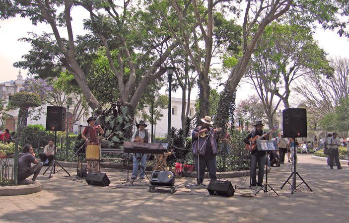Peruvian musicians playing for tips, selling their CD's