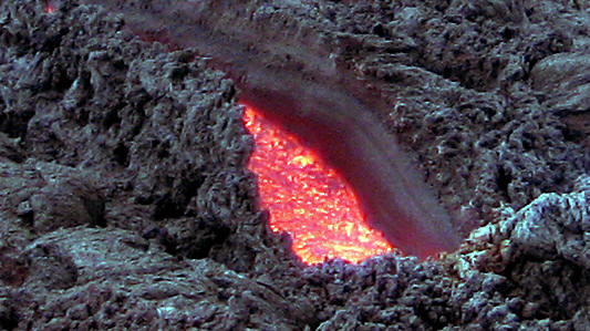 A ripped open area with molten lava showing