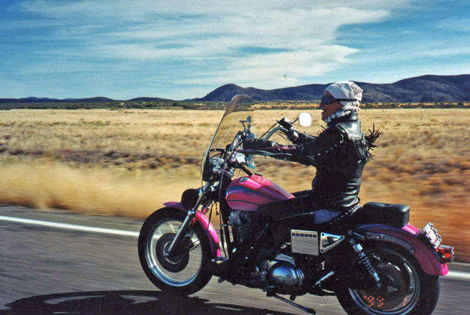Lynne on her motorcycle, riding through northern Arizona