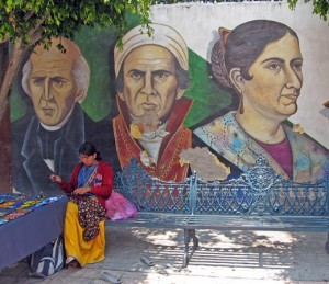 Native in front of mural, Ajijic, Mexico