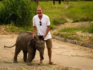 Playing with elephants, Thailand
