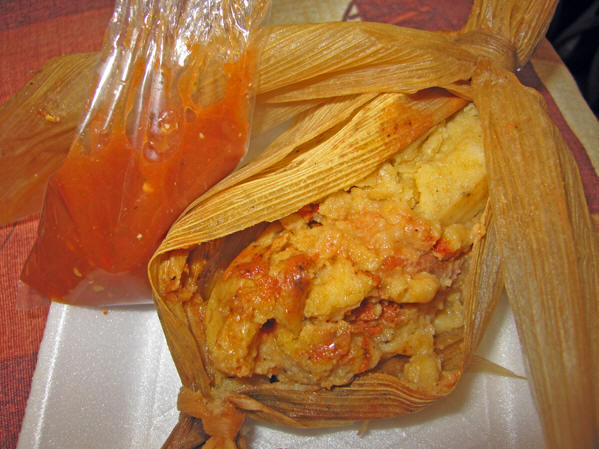 Fresh cornhusk-wrapped tamales with salsa!