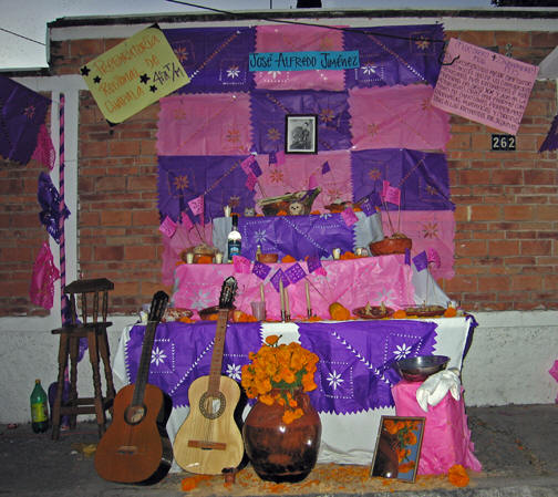 Papel picado lines the back wall and table of this memorial. Day of the Dead, Chapala, Mexico