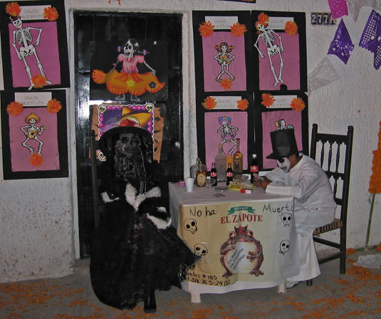 Mimes sitting at a table representing a local restaurant. Days of the Dead, Chapala, Mexico