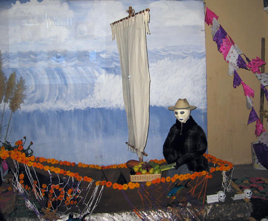 A fisherman in his marigold-lined boat. Days of the Dead, Chapala, Mexico
