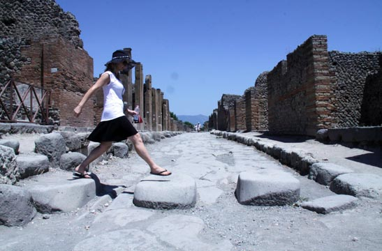 Lori walking the ancient city streets of Pompeii, Italy.