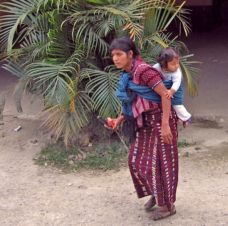 This Mayan woman carries her child on her back in traditional fashion