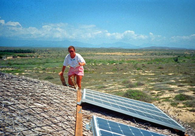 Suzanne installing Solar Panels on a Palapa in Todos Santos, Mexico