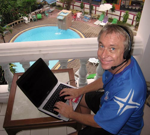Billy at his computer keeping up with the markets and global events while in Thailand
