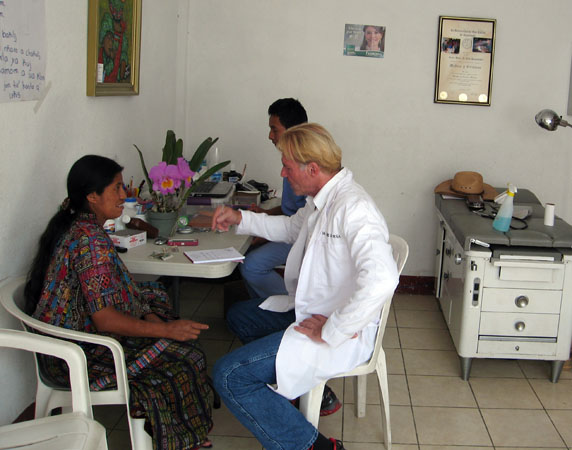 Dr. Luis Pena and his assistant with a local Maya in the clinic