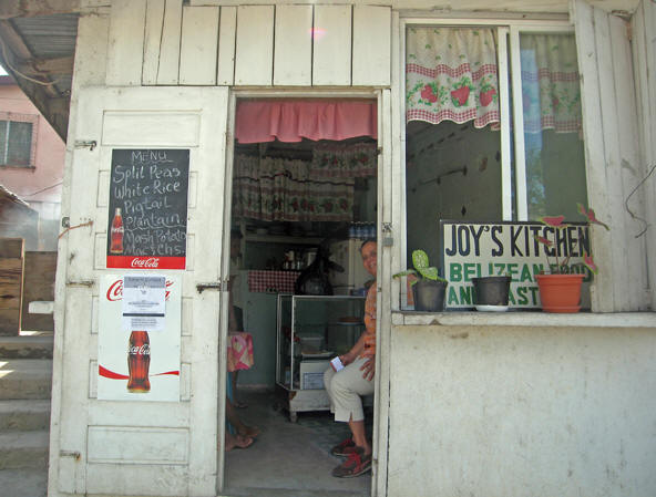 Joy offers pigtail and plantain in San Ignacio, Belize