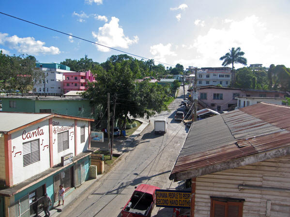 Sometimes there are sidewalks in front of buildings, but not every one of them. San Ignacio, Belize.