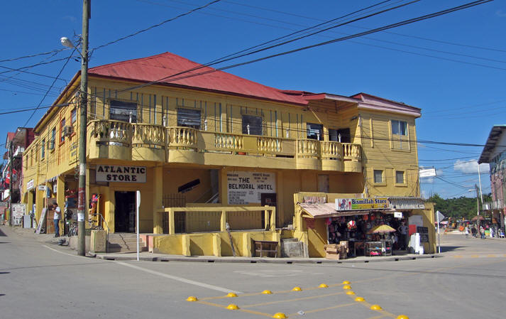 A high-end corner with well kept road and building.  San Ignacio, Belize