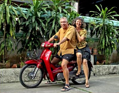 Billy and Akaisha on a motorbike in Chiang Mai, Thailand
